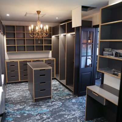 Dark plywood exposed edge walk in wardrobe