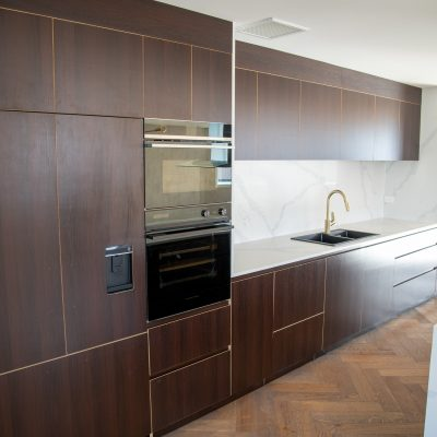 Dark wood integrated plywood kitchen Auckland
